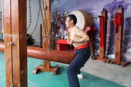"China's ""Iron Crotch"" Masters Fight To Preserve Painful Tradition"